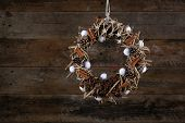 Decorated Christmas Wreath Pine Cones Cotton Buds Anise Cinnamon On Old Rustic Background