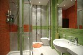 bathroom in perspective in green and orange colors