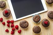 Muffins and tablet on the table
