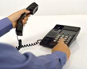 Man Using A Telephone