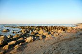 Tranquil coastal sunset on sea beach