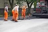DUSSELDORF, GERMANY - JULY 30: Workers laid asphalt on a street in Dusseldorf, Germany on July 30, 2