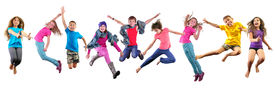 picture of children group  - Large group of happy children exercising jumping and having fun. Isolated over white background. Childhood happiness active lifestyle concept ** Note: Soft Focus at 100%, best at smaller sizes - JPG