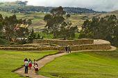 Unidentified tourists visiting Ingapirca, important Inca ruins in Ecuador