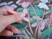 Hand drawing a picture with pink crayon