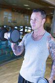 Man Making Alternate Curl - Workout Routine .