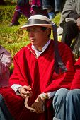 Unidentified indigenous man watching the celebration of Inti Raymi, Inca Festival of the Sun in Inga