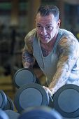 Man Making Dumbbell Kickback - Workout Routine .