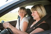 Mature woman with daughter driving car