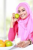 picture of muslimah  - portrait of healthy breakfast of young muslim woman - JPG