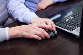 Hand Of An Elderly Woman And A Boy's Hand Holding A Computer Mouse