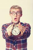 picture of nerd glasses  - Nerd guy y in glasses with alarm clock - JPG