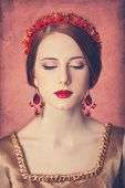 stock photo of redhead  - Portrait of the beautiful redhead women in wreath - JPG