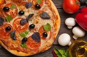 Pizza Margherita With Tomatoes, Pepper, Olives And Basil On Vintage Rustic Background