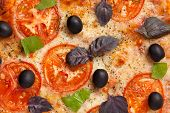 Traditional Italian Pizza Margherita With Tomatoes, Olives And Basil Close Up