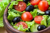 Superfood Vegetarian Salad With Tomato And Olives On Rustic Background