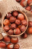 Hazelnut Superfoods In Wooden Dish On Vintage Textile