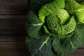 Savoy Cabbage Superfood On Dark Wooden Background
