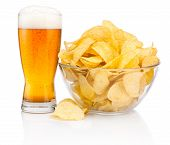 Glass Of Beer And Potato Chips In Glass Bowl Isolated On White Background