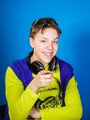 Teenage Boy Listening Music In Headphones