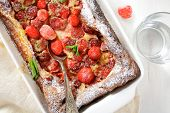 Sweet Pudding With Strawberries In A Baking Dish