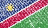Flag Of Namibia With Old Texture. Vector