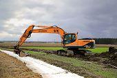Hyundai Robex 210LC-9 Crawler Excavator On A Field At Spring