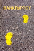 Yellow Footsteps On Sidewalk Towards Bankruptcy Message