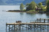 Chairs at the pier of a fjord in Balestrand Norway.