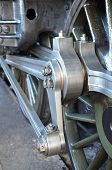 foto of train-wheel  - Large British steam train showing wheel and connecting rods - JPG