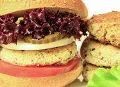 stock photo of veggie burger  - Vegan sea burger and patties closeup background - JPG