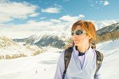 Cheerful Female Skier In Ski Resort