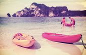 Retro Filtered Picture Of Kayaks On A Tropical Beach.