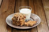Granola Bars With Glass Of Milk On Wooden Background