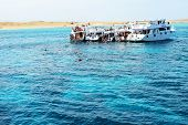 Hurghada, Egypt -  December 6: Snorkeling Tourists And Motor Yachts On Red Sea. It Is Popular Touris