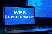 Computer with words web development.