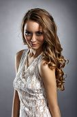picture of fascinator  - Fascinating young model posing in sexy negligee - JPG
