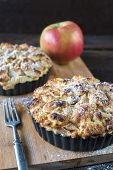 picture of pie-in-face  - Selective focus on the front baked apple pie on wooden background - JPG