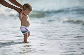 stock photo of children beach  - little boy at the beach with parent - JPG