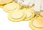 stock photo of medal  - Gold medals with copy space isolated on white - JPG
