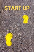 Yellow Footsteps On Sidewalk Towards Start Up Message