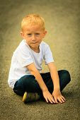 foto of thoughtfulness  - Portrait of thoughtful pensive little boy child or kid in summer park - JPG