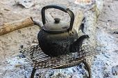 picture of boiling water  - Old Kettle Boiling Water For Coffee Or Tea In Countryside In Thailand - JPG