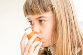 picture of inhalant  - Seven year old girl breathing asthmatic medicine healthcare inhaler - JPG