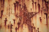 picture of iron star  - Rust star shpe on iron plate background texture - JPG