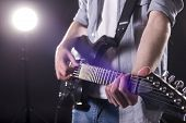 stock photo of guitar  - Guitar player - JPG