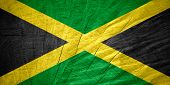 stock photo of jamaican flag  - Jamaica flag or Jamaican banner on wooden texture - JPG