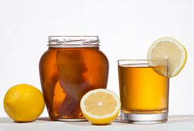 stock photo of pro-life  - Kombucha super food pro biotic beverage in glass with lemon on white background - JPG