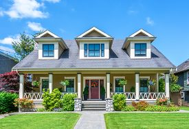 image of in front  - Luxury house with beautiful landscaping on a sunny day - JPG