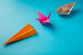picture of float-plane  - row of colored paper origami plane crane - JPG